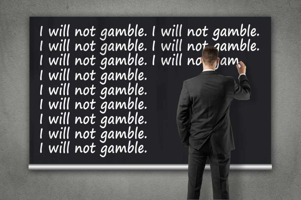 businessman writing on wall - I will not gamble